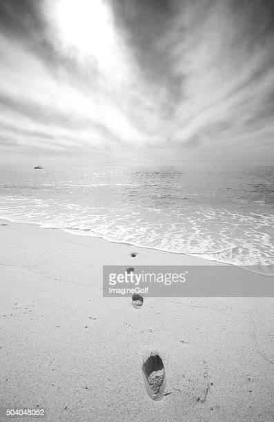 Black and White of Footsteps on the Beach