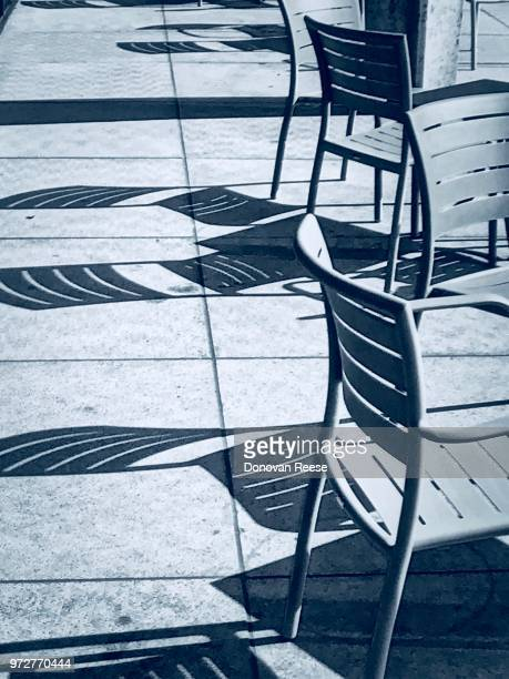 Black and White.  Outdoor chairs and shadows