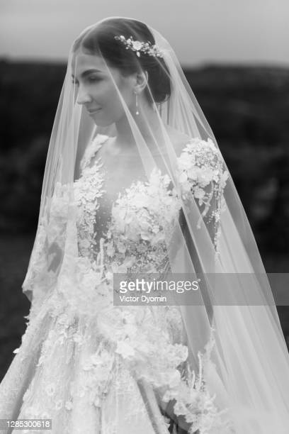 black and white outdoor portrait of the gorgeous bride - marriage stock pictures, royalty-free photos & images