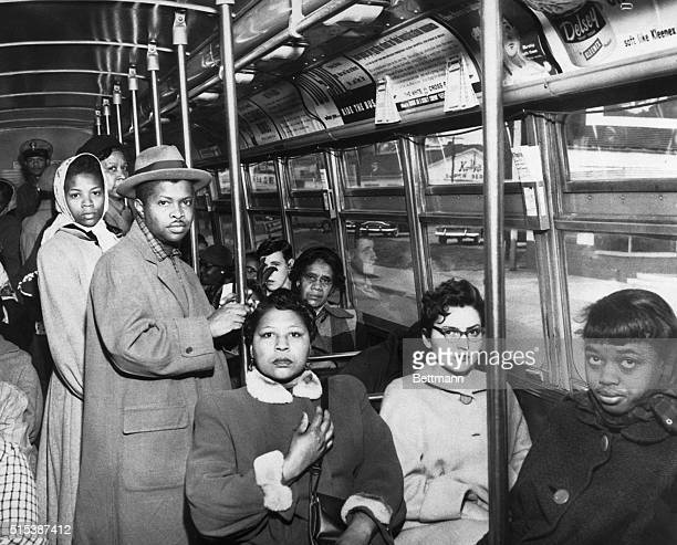 Black and white passengers sit side by side on a Norfolk Virginia bus as racial segregation of intrastate transportation ended per US Supreme Court...