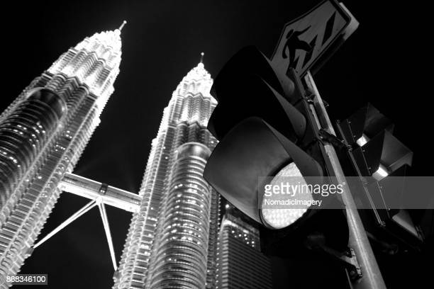 Black and white Petronas Towers at night low angle traffic lights foreground