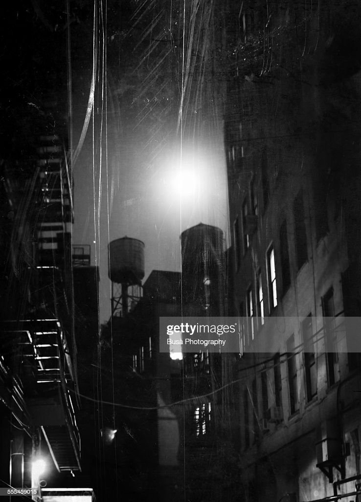 Black and white photo of a dark alley at nigth, NY : Stock Photo