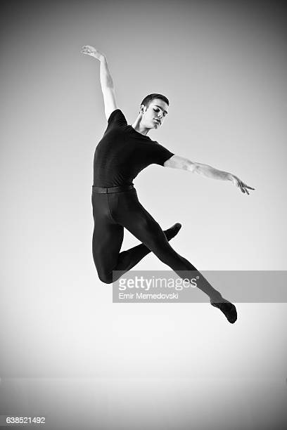 black and white photo of a male ballet dancer jumping - male ballet dancer stock photos and pictures