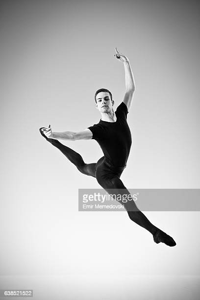 Black and white photo of a male ballet dancer jumping