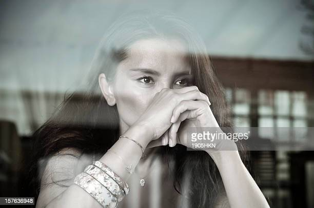 black and white photo of a woman looking out a window - fine art portrait stock photos and pictures