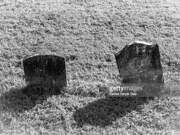 black and white photo of old tombstones - panyik-dale stock photos and pictures