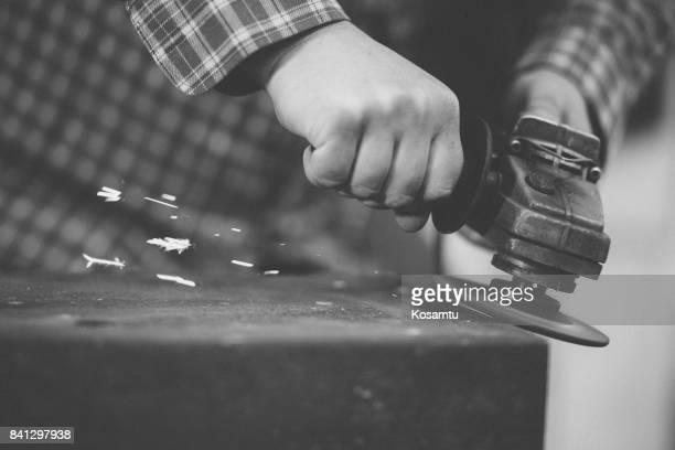 Black And White Photo Of Welder Using Grinder