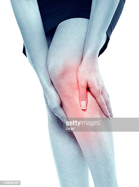 a black and white photo showing red knee pain - feet torture stock pictures, royalty-free photos & images