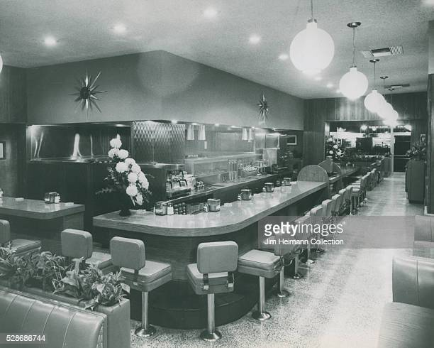 Black and white photograph featuring unoccupied counter and midcentury design