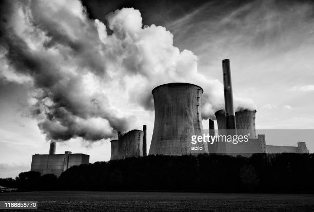 black and white photograph of a coal fired power plant with pollution - coal fired power station stock pictures, royalty-free photos & images