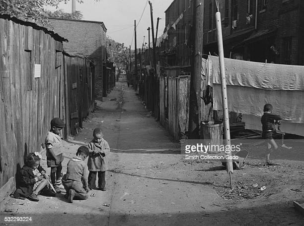 Black and white photograph of AfricanAmerican children playing in the Defrees Alley NE near the Capitol Building Washington DC 1877 From the New York...