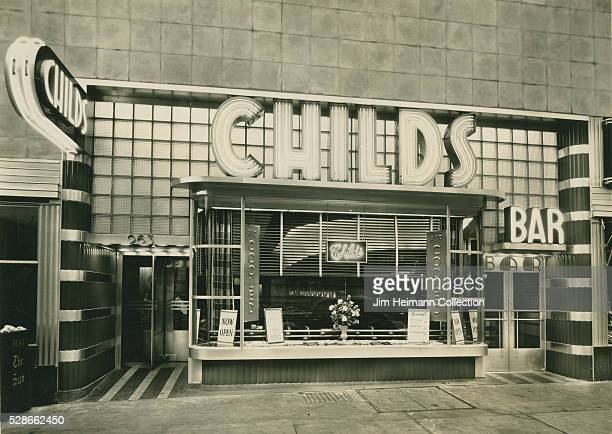 Black and white photograph of Childs exterior featuring bar sign and front window