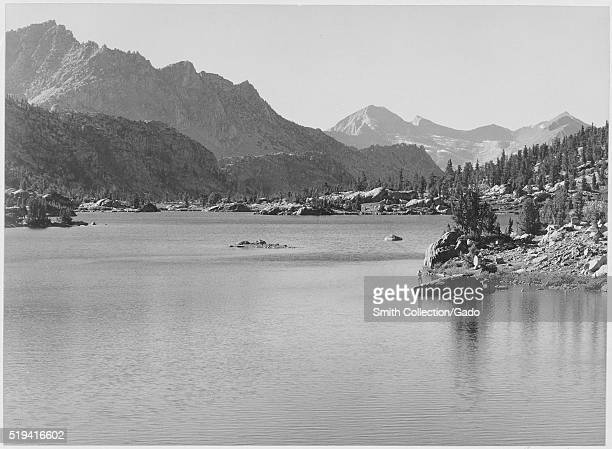 A black and white photograph of Rac Lake at King's Canyon National Park the photograph comes from a series taken by Ansel Adams in collaboration with...