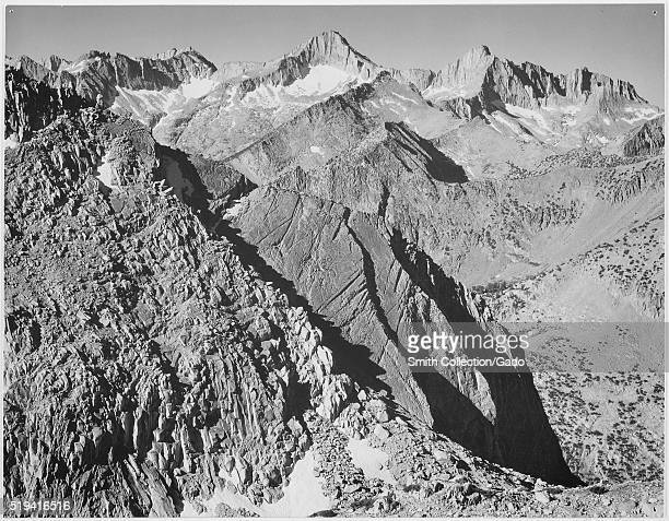 Black and white photograph of rocky mountain range captioned 'Mount Brewer Kings River Canyon ' by Ansel Adams from Photographs of National Parks and...