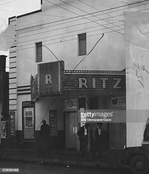 Black and white photograph of the Ritz theater in Louisiana, site of race riots during World War II which started when African-American soldiers from...