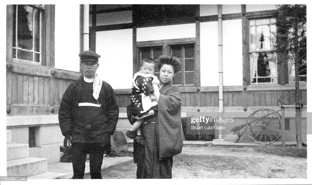 black and white photograph on cardstock of a japanese man and woman