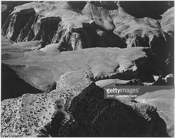 Black and white photograph view from Yava Point rock formations and valley captioned 'Grand Canyon National Park' by Ansel Adams from Photographs of...
