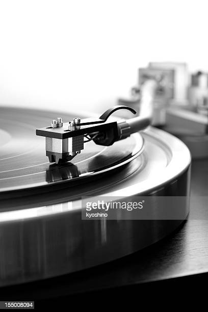 Black and White photography of Record Player against white background