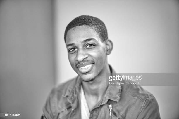 a black and white portrait of a 19 year old young man - 18 19 anos - fotografias e filmes do acervo