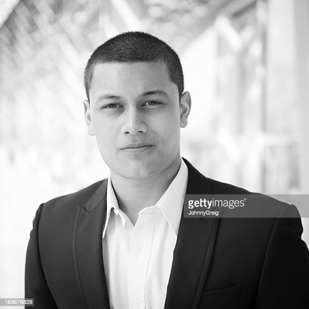 Black and white portrait of a young businessman.