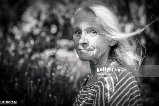 Black and white portrait of attractive mature woman, copy space