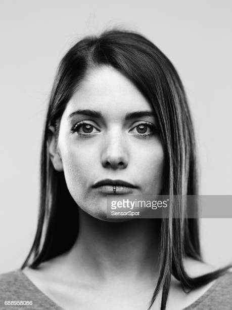 black and white portrait of confident real young woman - black and white face stock photos and pictures