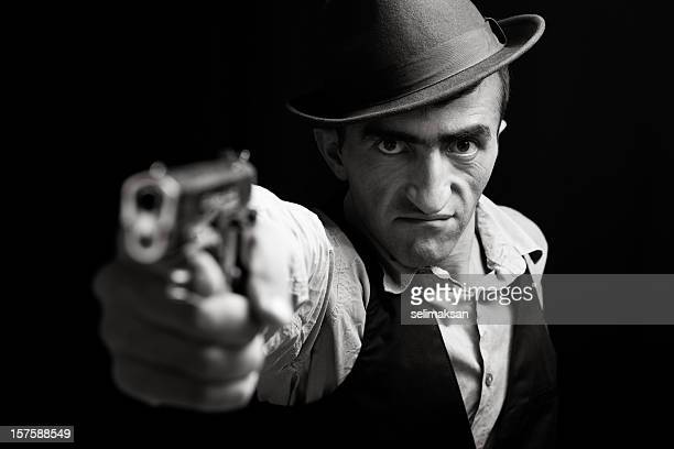Black And White Portrait Of Furious Gang Member Pointing Gun