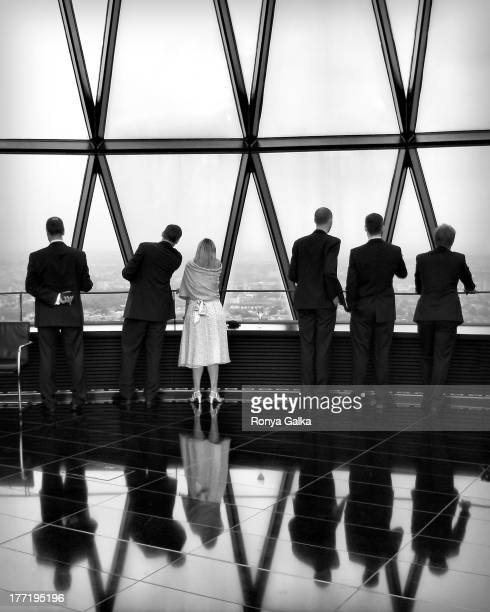 CONTENT] Black and white portrait of group of people in evening wear in London urban documentary