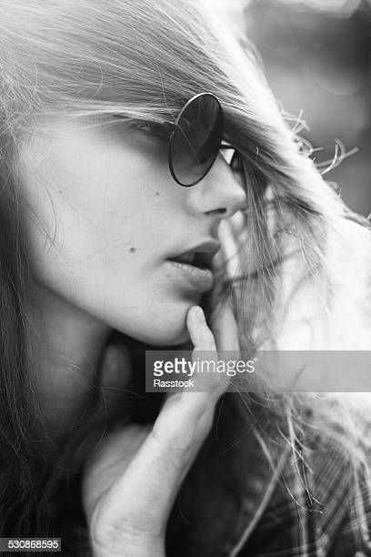 Black and white portrait of hippie style girl