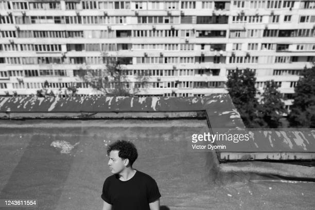black and white portrait of the man on the old rooftop - former soviet union stock pictures, royalty-free photos & images