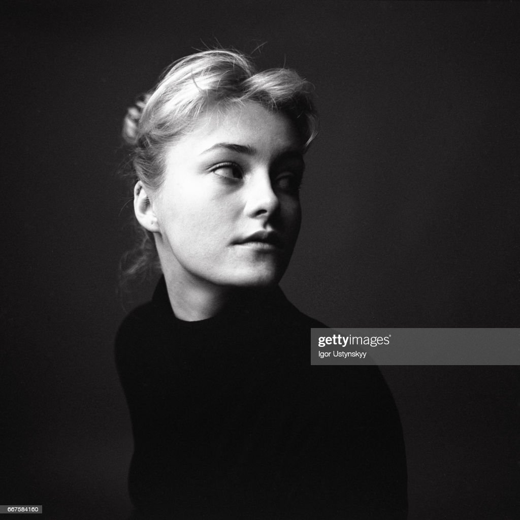 Black and white portrait of woman on the black background : Stock Photo