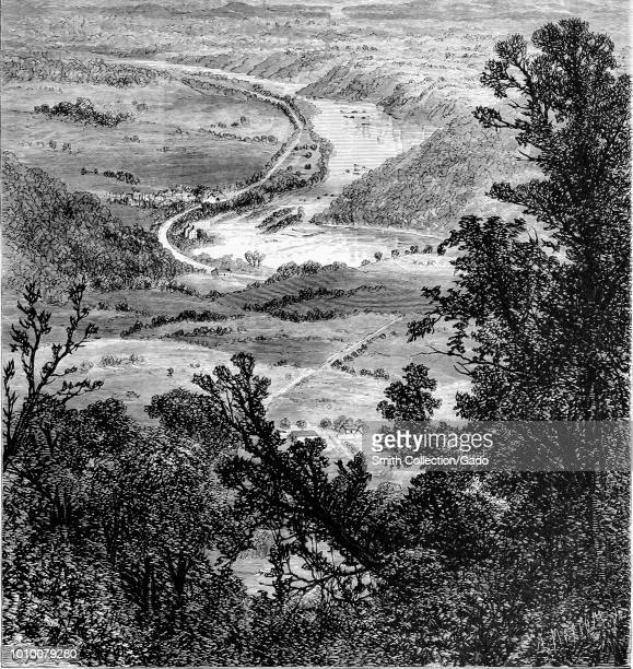 Black and white print depicting a view of the Potomac River from the perspective of Maryland Heights, with foliage in the foreground and cultivated...