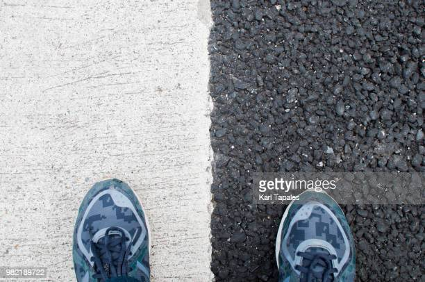 black and white road - separation stock pictures, royalty-free photos & images