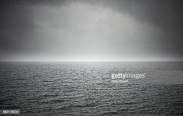 Black and white seascape with stormy sky