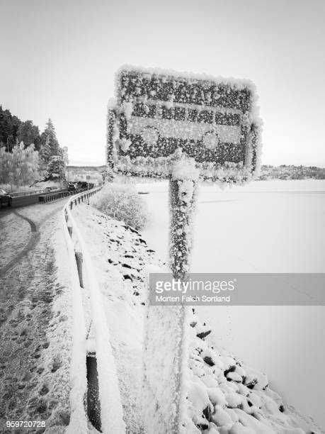 Black and White Shot of a Snow-Covered Roadside Sign in Rural Buskerud, Norway Wintertime