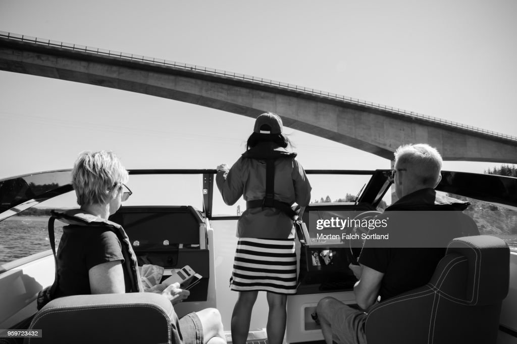 Black and White Shot of People on a  Motorboat in Lauvoy, Norway on a Bright Summer Day : Stock-Foto