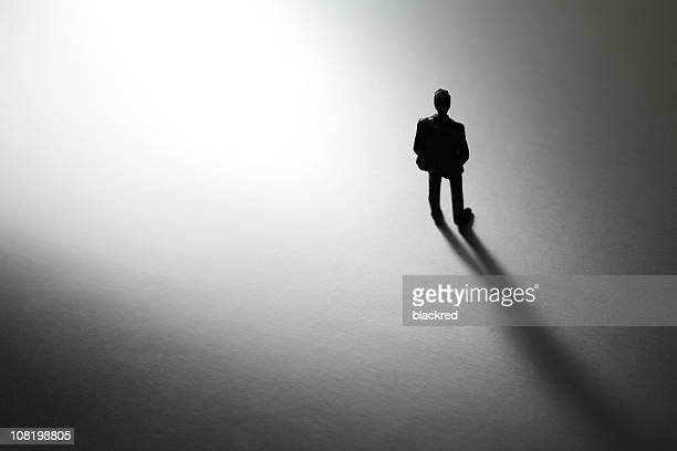 black and white shot of plastic toy businessman, low key - human representation stock pictures, royalty-free photos & images