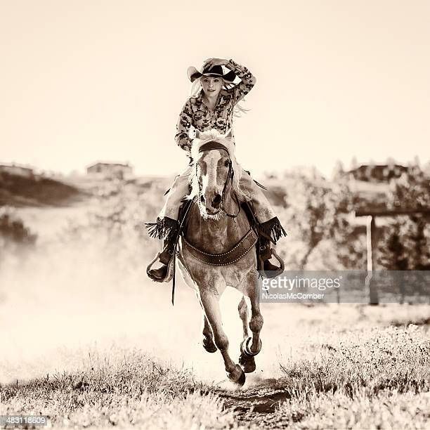 Black and white shot of young woman on horseback