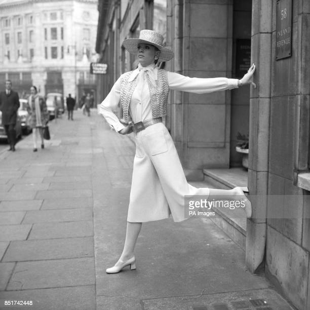 Black and white snakeskin bolerc and matching snakeskin poncho hat worn by Doreen, with white culottes in fine wool and a white crepe shirt in...