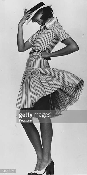 Black and white striped dress with a trilby style hat in the Spring and Summer Collection from Christian Dior, Paris.