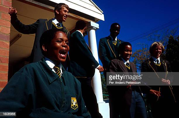 Black and white students stand outside June 21 2001 Vryburg High School in Vryburg South Africa Vryburg a small and very conservative farming town...