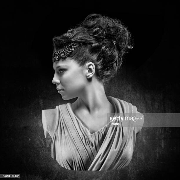 Black and white studio shot bust of beautiful female model posing as ancient Greek Goddess