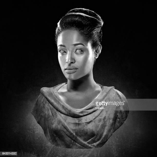 Black and white studio shot bust of beautiful female model posing as ancient Greek Goddess