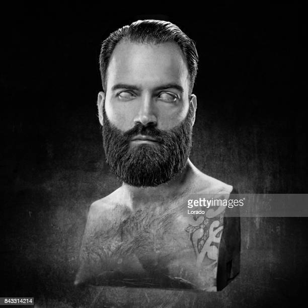 Black and white studio shot bust of handsome male model posing as ancient Greek God