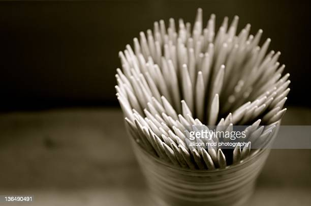 Black and white toothpicks in jar