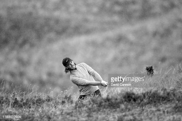 Black and white version of original colour image; Tommy Fleetwood of England plays his second shot on the eighth hole during the final round of the...