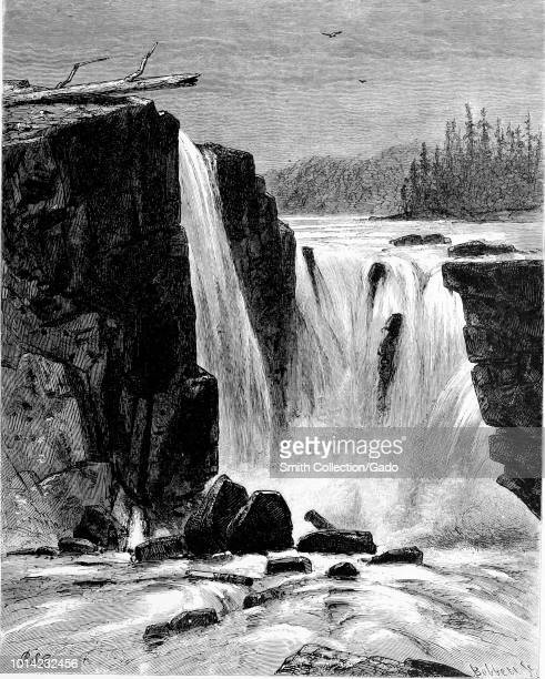 Black and white vintage print depicting the southern side of the Willamette Falls a horseshoeshaped natural waterfall located on the Willamette River...