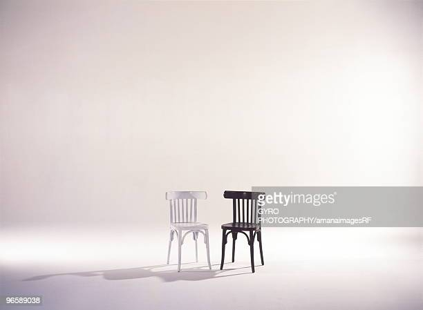 Black and white wooden chairs side by side