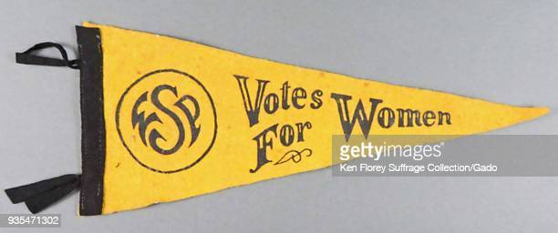 Black and yellow pennant or banner produced for the American market with the message Votes for Women and a circular logo with the initials WSP to...
