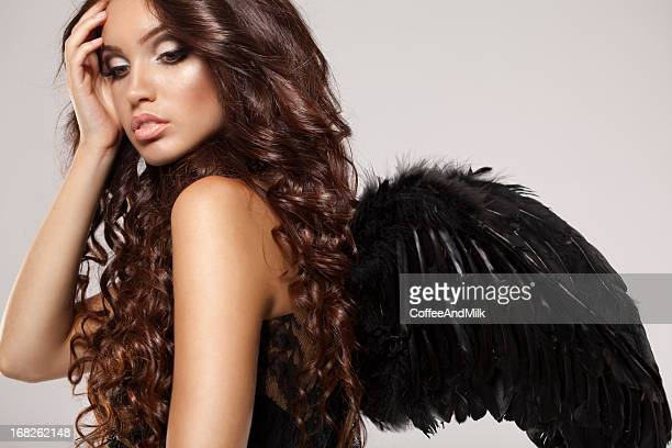 Black angel with perfect hairstyle and makeup